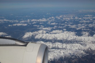 View out of the window during flight over Swiss Alps.